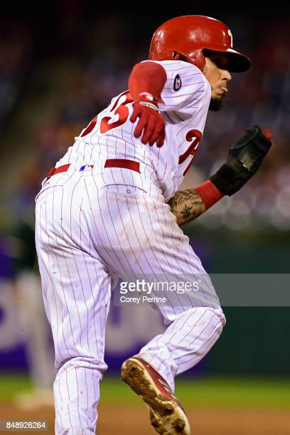 Freddy Galvis of the Philadelphia Phillies looks to advance to second base against the Oakland Athletics during the fifth inning at Citizens Bank...