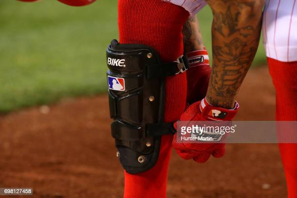 Freddy Galvis of the Philadelphia Phillies puts on his Bike shin guard during a game against the Cincinnati Reds at Citizens Bank Park on May 26 2017...
