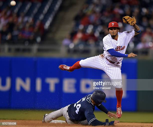 Freddy Galvis of the Philadelphia Phillies puts out Jon Jay of the San Diego Padres on an attempted double in the eighth inning play at Citizens Bank...