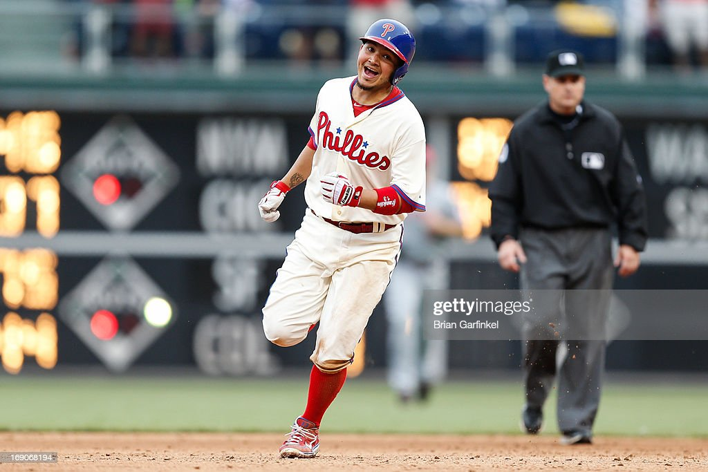 Freddy Galvis #13 of the Philadelphia Phillies runs the bases after hitting a home run in the bottom of the ninth inning to win the game against the Cincinnati Reds at Citizens Bank Park on May 19, 2013 in Philadelphia, Pennsylvania. The Phillies won 3-2.