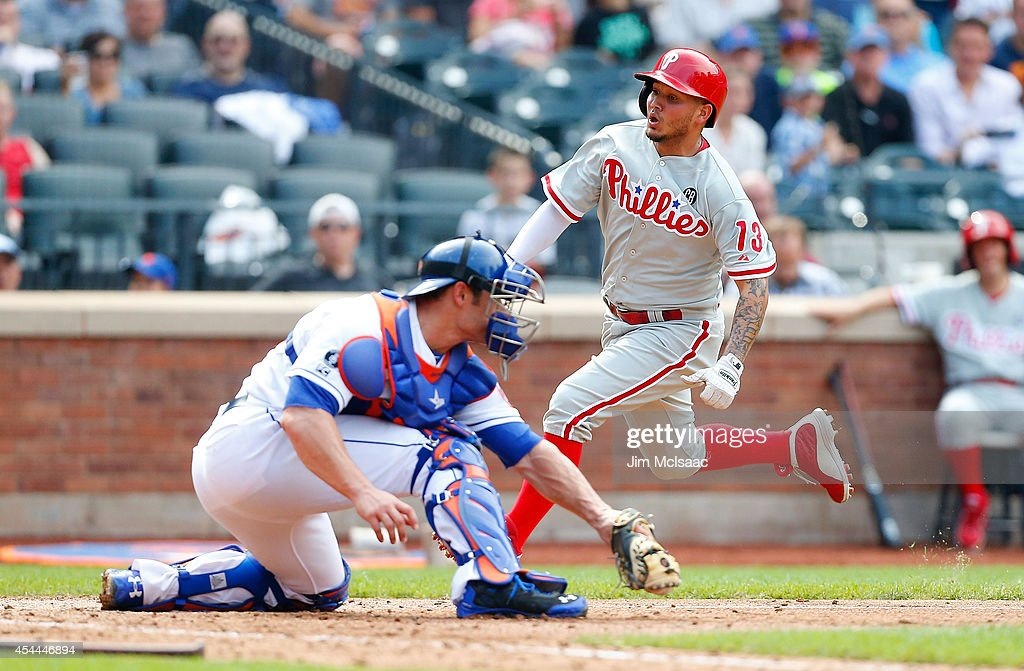 <a gi-track='captionPersonalityLinkClicked' href=/galleries/search?phrase=Freddy+Galvis&family=editorial&specificpeople=6772271 ng-click='$event.stopPropagation()'>Freddy Galvis</a> #13 of the Philadelphia Phillies scores a seventh inning run past Anthony Recker #20 of the New York Mets at Citi Field on August 31, 2014 in the Flushing neighborhood of the Queens borough of New York City.
