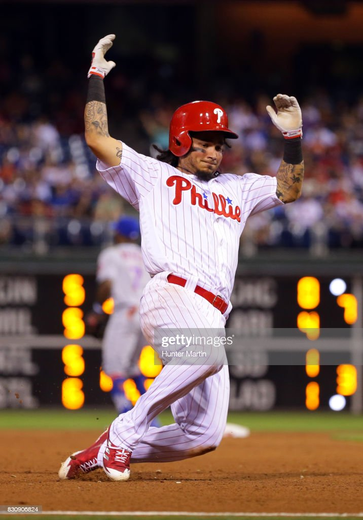 Freddy Galvis #13 of the Philadelphia Phillies slides into third base in the eighth inning during a game against the New York Mets at Citizens Bank Park on August 12, 2017 in Philadelphia, Pennsylvania. The Phillies won 3-1.
