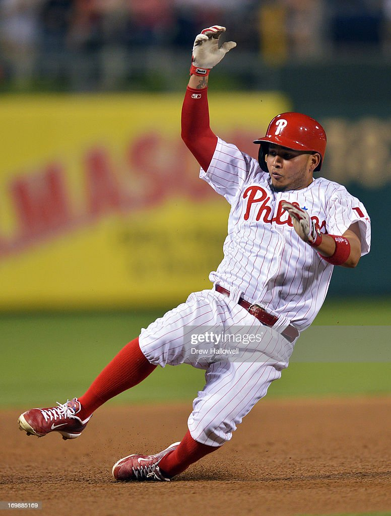 Freddy Galvis #13 of the Philadelphia Phillies slides into third base on a triple in the sixth inning against the Miami Marlins at Citizens Bank Park on June 3, 2013 in Philadelphia, Pennsylvania. The Phillies won 7-2.