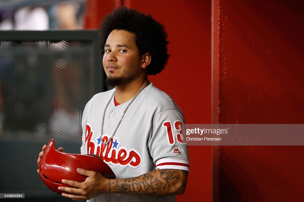 <a gi-track='captionPersonalityLinkClicked' href=/galleries/search?phrase=Freddy+Galvis&family=editorial&specificpeople=6772271 ng-click='$event.stopPropagation()'>Freddy Galvis</a> #13 of the Philadelphia Phillies stands in the dugout during the first inning of the MLB game against the Arizona Diamondbacks at Chase Field on June 29, 2016 in Phoenix, Arizona.