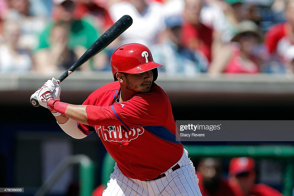 Freddy Galvis #13 of the Philadelphia Phillies swings at a pitch in the first inning of a game against the Pittsburgh Pirates at Bright House Field on March 16, 2014 in Clearwater, Florida. Pittsburgh won the game 5-0.