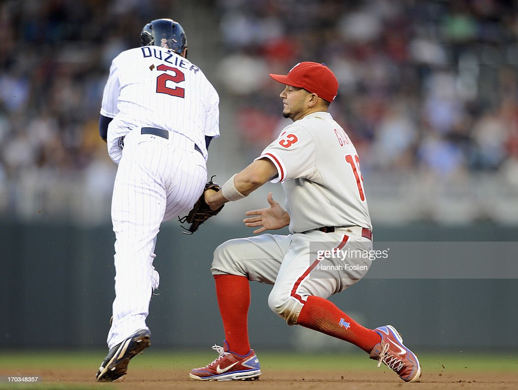 Freddy Galvis #13 of the Philadelphia Phillies tags out <a gi-track='captionPersonalityLinkClicked' href=/galleries/search?phrase=Brian+Dozier&family=editorial&specificpeople=7553002 ng-click='$event.stopPropagation()'>Brian Dozier</a> #2 of the Minnesota Twins to start a double play during the fourth inning of the game on June 11, 2013 at Target Field in Minneapolis, Minnesota.
