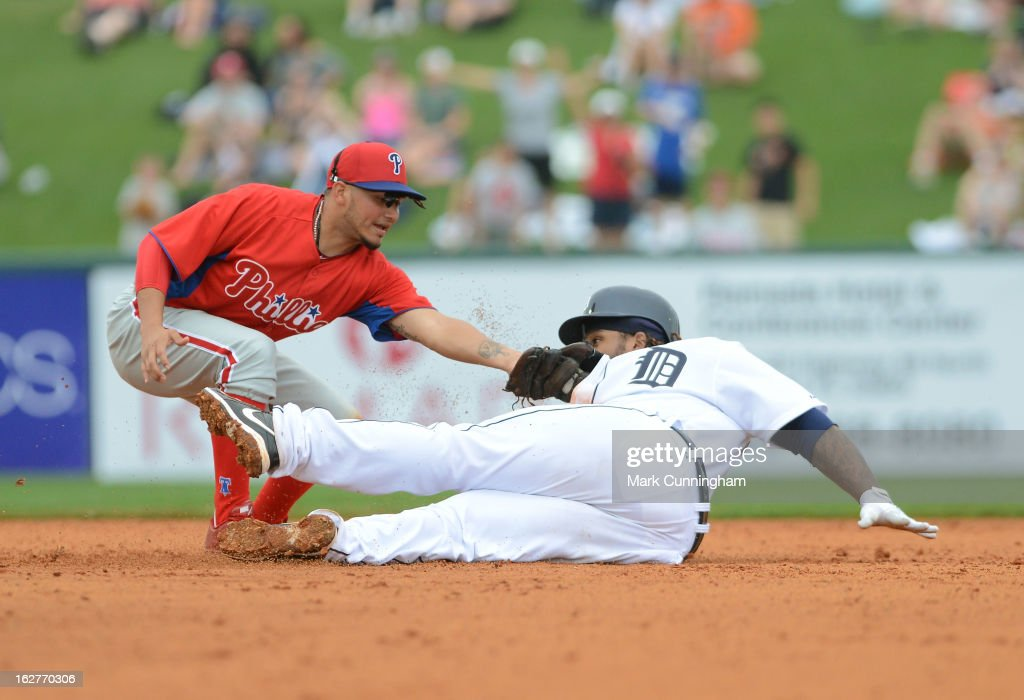 Freddy Galvis #13 of the Philadelphia Phillies tags out Prince Fielder #28 of the Detroit Tigers on a play at second base during the spring training game at Joker Marchant Stadium on February 24, 2013 in Lakeland, Florida. The game ended in a 10 inning 5-5 tie.