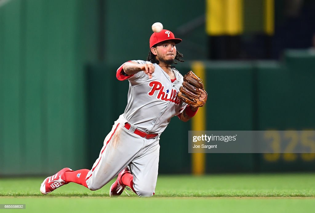 Freddy Galvis #13 of the Philadelphia Phillies throws over to second base during the ninth inning against the Pittsburgh Pirates at PNC Park on May 19, 2017 in Pittsburgh, Pennsylvania.