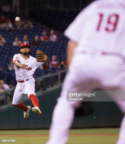 Freddy Galvis of the Philadelphia Phillies throws the ball to Tommy Joseph of the Philadelphia Phillies in an unsuccessful attempt to get out Jeremy...
