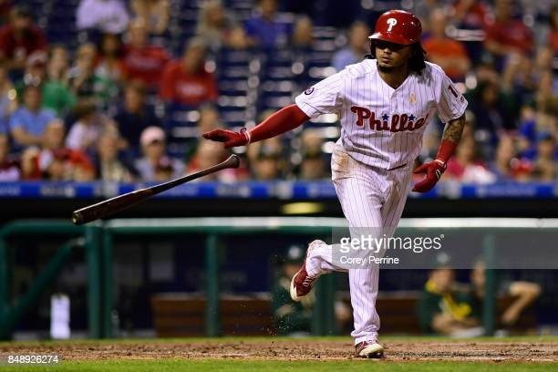Freddy Galvis of the Philadelphia Phillies tosses his bat after being walked against the Oakland Athletics during the fifth inning at Citizens Bank...