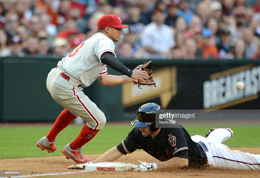 <a gi-track='captionPersonalityLinkClicked' href=/galleries/search?phrase=Freddy+Galvis&family=editorial&specificpeople=6772271 ng-click='$event.stopPropagation()'>Freddy Galvis</a> #13 of the Philadelphia Phillies waits for the ball as AJ Pollock #11 of the Arizona Diamondbacks slides safely into third base during the second inning at Chase Field on April 26, 2014 in Phoenix, Arizona.