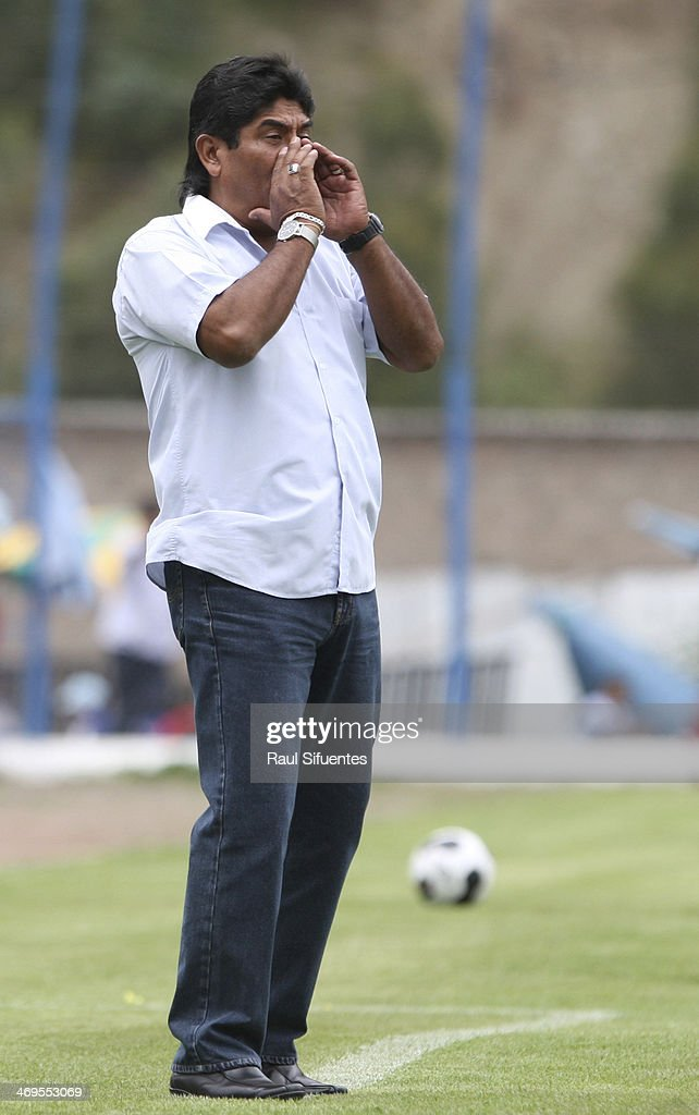Freddy Garcia head coach of Real Garcilaso, gestures during a match between Real Garcilaso and Sporting Cristal as part of the Copa Inca at Municipal de Urcos Stadium on Februay 15, 2014 in Cuzco, Peru.