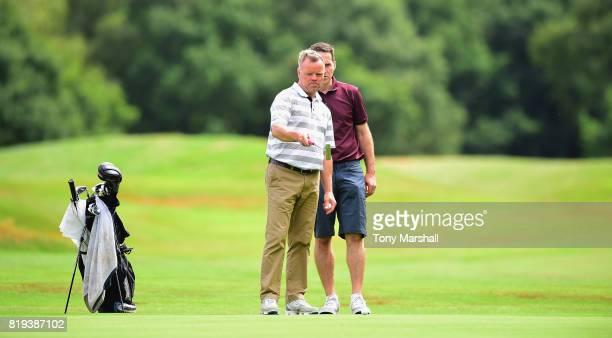 Freddy George and John Foley of North Middlesex Golf Club line up a putt on the 17th green during the PGA Lombard Trophy East Qualifier at Sandy...