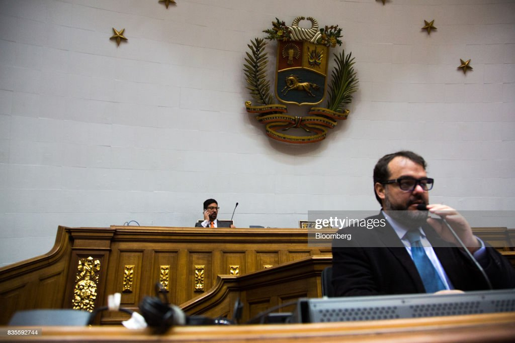 Freddy Guevara, vice president of the National Assembly, left, speaks on a mobile phone before a special session of the National Assembly of Caracas, Venezuela, on Saturday, Aug. 19, 2017. Venezuela's new legislative super body took over the functions of the country's only remaining opposition-run institution -- the National Assembly -- by approving a decree that empowers it to pass laws on a range of issues. Photographer: Wil Riera/Bloomberg via Getty Images