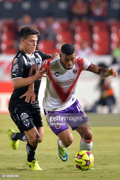Freddy Hinestroza of Puebla fights for the ball during the 16th round match between Veracruz and Monterrey as part of the Torneo Clausura 2017 Liga...