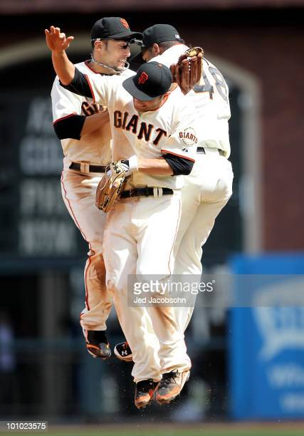 Freddy Sanchez Andres Torres and Pablo Sandoval of the San Francisco Giants celebrate after defeating the Washington Nationals during an MLB game at...