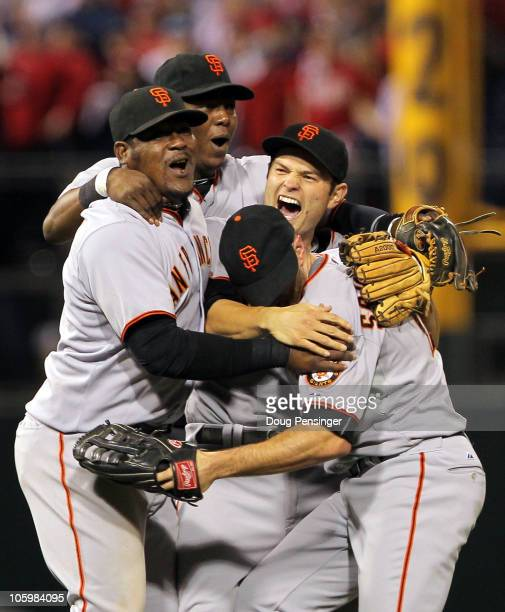 Freddy Sanchez Juan Uribe Edgar Renteria and Nate Schierholtz of the San Francisco Giants celebrate defeating the Philadelphia Phillies 32 and...
