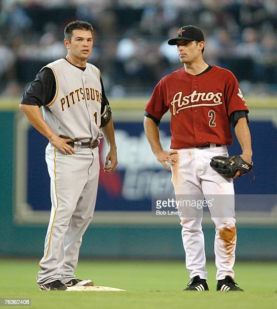 Freddy Sanchez of the Pittsburgh Pirates and Chris Burke of the Houston Astros talks during a pitching change in the MLB game on August 26 2007 at...