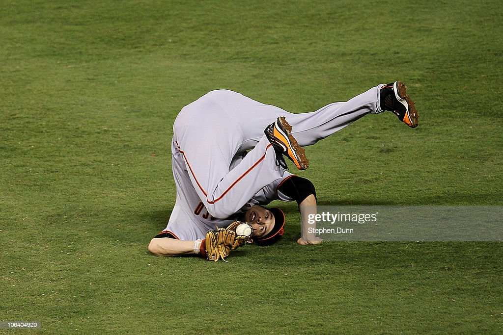 <a gi-track='captionPersonalityLinkClicked' href=/galleries/search?phrase=Freddy+Sanchez&family=editorial&specificpeople=220611 ng-click='$event.stopPropagation()'>Freddy Sanchez</a> #21 of the San Francisco Giants catches a line out for an out hit by Jeff Francoeur #21 of the Texas Rangers in the bottom of the second inning Game Four of the 2010 MLB World Series at Rangers Ballpark in Arlington on October 31, 2010 in Arlington, Texas.