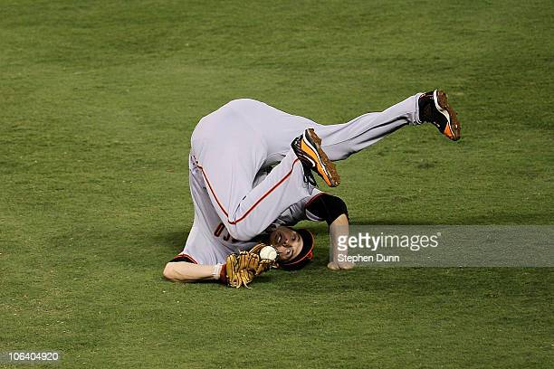 Freddy Sanchez of the San Francisco Giants catches a line out for an out hit by Jeff Francoeur of the Texas Rangers in the bottom of the second...