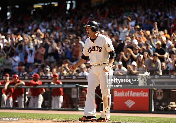 Freddy Sanchez of the San Francisco Giants celebrates after he scored on a single by Jose Guillen to tie their game 66 in the seventh inning of their...