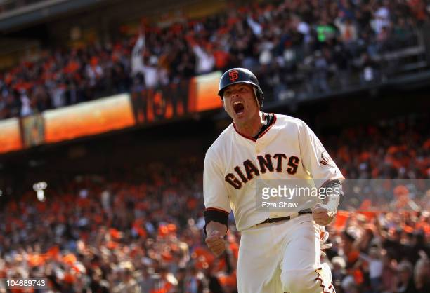 Freddy Sanchez of the San Francisco Giants celebrates after he scored on a double to give the Giants a 20 lead in the third inning of their game...