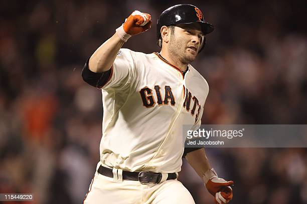 Freddy Sanchez of the San Francisco Giants celebrates after the game winning hit in the 13th inning against the Washington Nationals during an MLB...