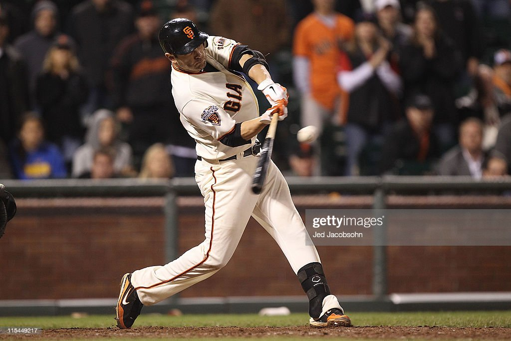 <a gi-track='captionPersonalityLinkClicked' href=/galleries/search?phrase=Freddy+Sanchez&family=editorial&specificpeople=220611 ng-click='$event.stopPropagation()'>Freddy Sanchez</a> #21 of the San Francisco Giants connects with the winning hit in the 13th inning against the Washington Nationals during an MLB game at AT&T Park on June 6, 2011 in San Francisco, California.