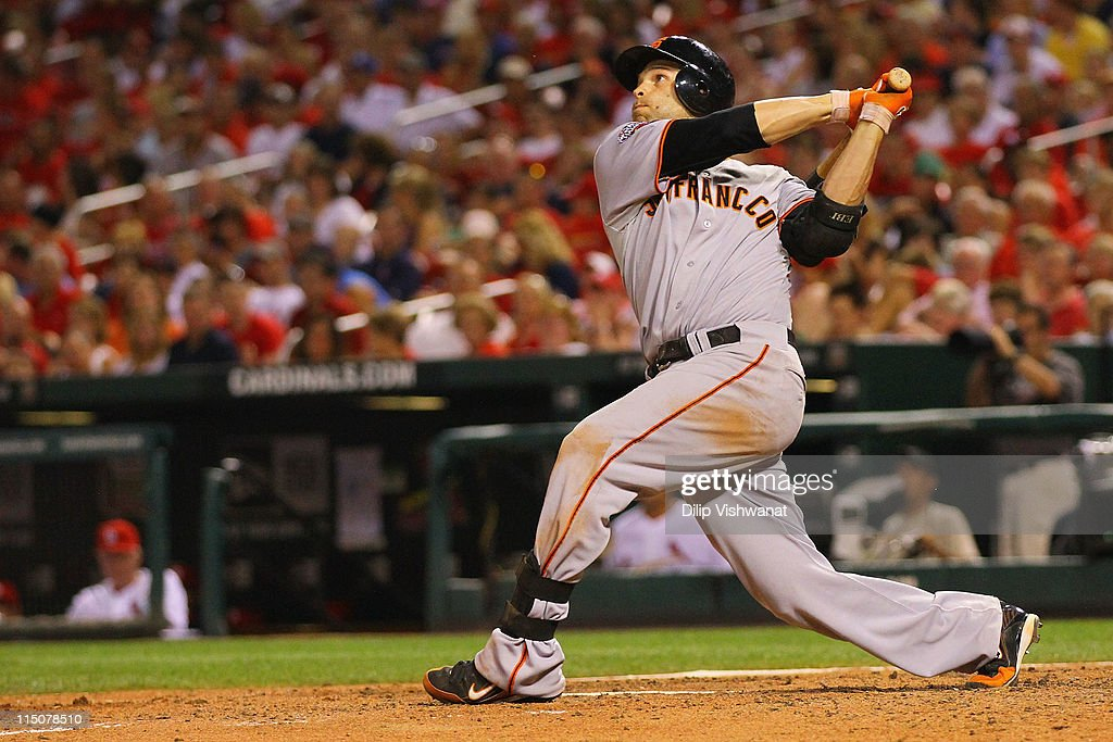 <a gi-track='captionPersonalityLinkClicked' href=/galleries/search?phrase=Freddy+Sanchez&family=editorial&specificpeople=220611 ng-click='$event.stopPropagation()'>Freddy Sanchez</a> #21 of the San Francisco Giants hits a three-run home run against the St. Louis Cardinals at Busch Stadium on June 2, 2011 in St. Louis, Missouri.