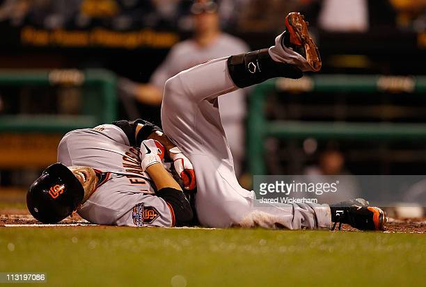 Freddy Sanchez of the San Francisco Giants lays on the ground in pain after being hit by a pitch during the game against the Pittsburgh Pirates on...