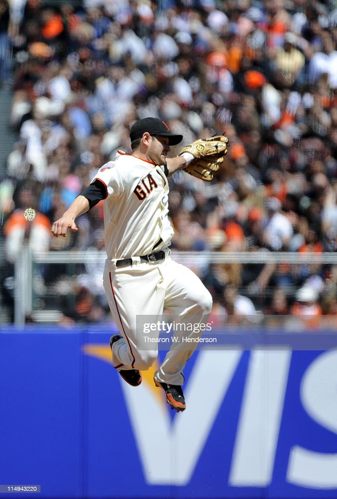 <a gi-track='captionPersonalityLinkClicked' href=/galleries/search?phrase=Freddy+Sanchez&family=editorial&specificpeople=220611 ng-click='$event.stopPropagation()'>Freddy Sanchez</a> #21 of the San Francisco Giants leaps but can't catch a line-drive against the Florida Marlins during a MLB baseball game at AT&T Park May 26, 2011 in San Francisco, California. The Marlins won the game 1-0.
