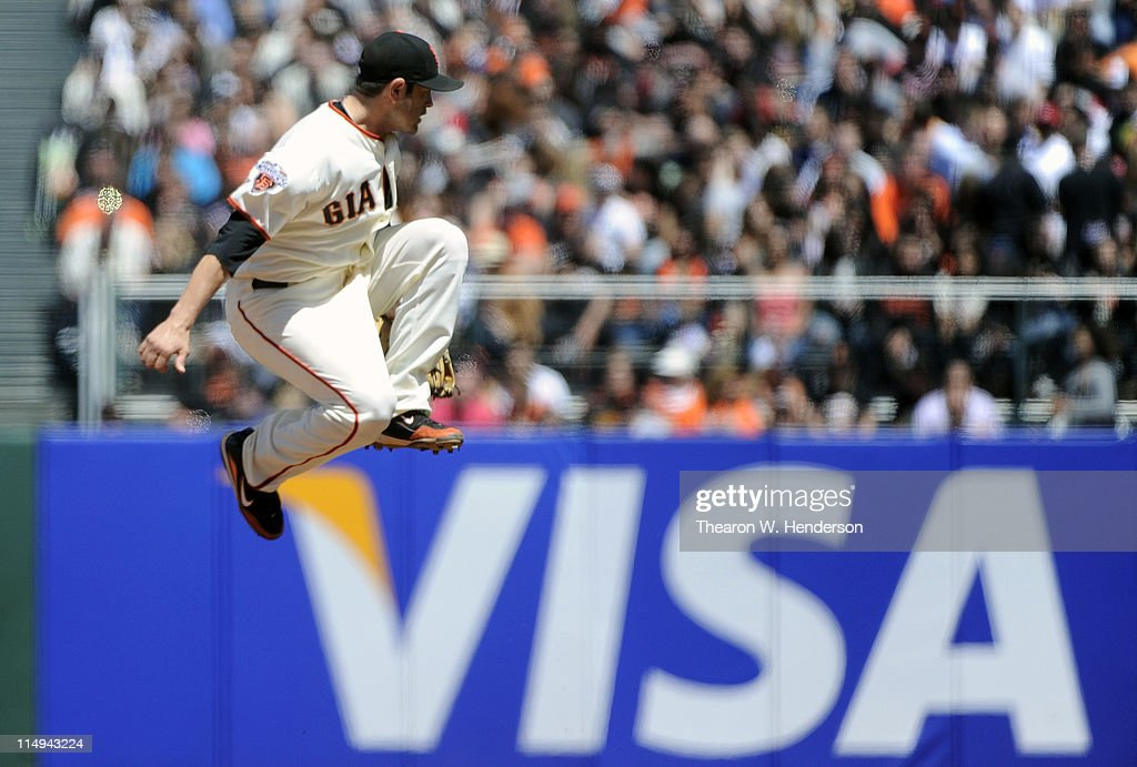 Freddy Sanchez #21 of the San Francisco Giants leaps but can't catch a line-drive against the Florida Marlins during a MLB baseball game at AT&T Park May 26, 2011 in San Francisco, California. The Marlins won the game 1-0.