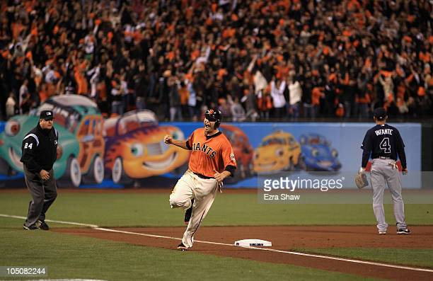 Freddy Sanchez of the San Francisco Giants reacts as he rounds third base on a home run by Pat Burrell in the first inning against the Atlanta Braves...