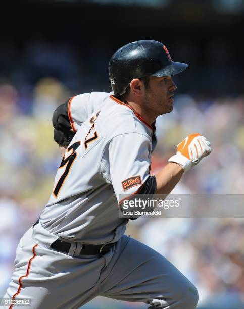 Freddy Sanchez of the San Francisco Giants runs to first base after hitting a single in the first inning against the Los Angeles Dodgers at Dodger...
