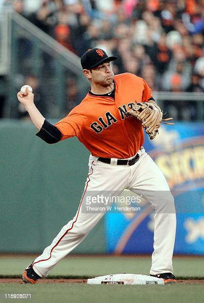 Freddy Sanchez of the San Francisco Giants turns the double play against the Cincinnati Reds during a MLB baseball game June 10 2011 at ATT Park in...