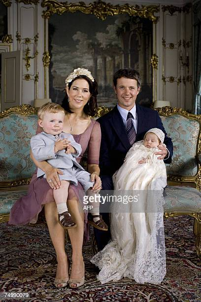 Danish Crown Princess Mary holds her son Prince Christian while her spouse Crown Prince Frederik holds their daughter Princess Isabella 01 July 2007...