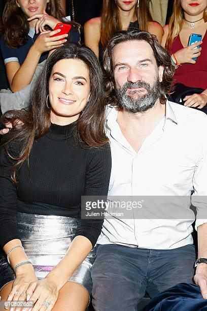 Frederic Beigbeder and his wife Lara Micheli attend the Etam show as part of the Paris Fashion Week Womenswear Spring/Summer 2017 on September 27...