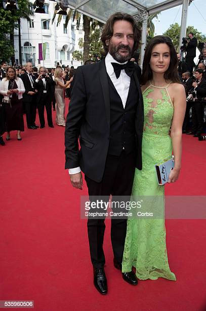 Frederic Beigbeder and Lara Micheli at the 'Saint Laurent' premiere during the 67th Cannes Film Festival