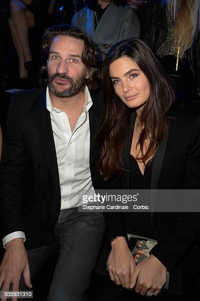 Frederic Beigbeder and Lara Micheli attend ETAM show as part of the Paris Fashion Week Womenswear Fall/Winter 20142015 in Paris