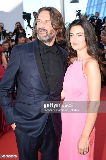 Frederic Beigbeder and Lara Micheli attend the '120 Beats Per Minute ' screening during the 70th annual Cannes Film Festival at Palais des Festivals...