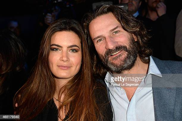 Frederic Beigbeder and Lara Micheli attend The ETAM show as part of the Paris Fashion Week Womenswear Fall/Winter 2015/2016 at Piscine Molitor on...