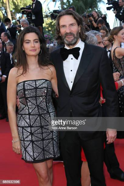 Frederic Beigbeder and Lara Micheli attend the 'Okja' screening during the 70th annual Cannes Film Festival at Palais des Festivals on May 19 2017 in...