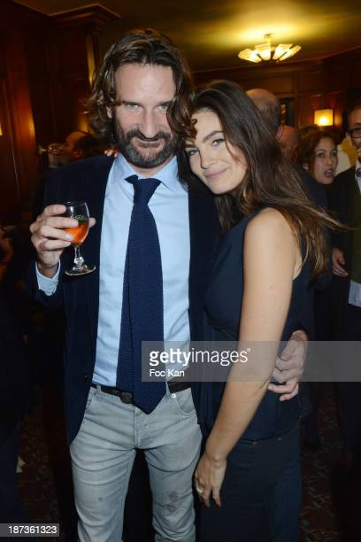 Frederic Beigbeder and Lara Micheli Beigbeder attend the Prix de Flore 2013' Ceremony Cocktail At Cafe De Flore on November 7 2013 in Paris France