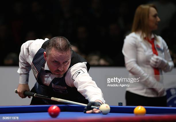 Frederic Coudron of Belgium competes against Dick Jaspers of Netherlands during the final match of the Carom Billiards 3 Cushion World Cup in Bursa...