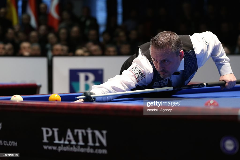 Frederic Coudron of Belgium competes against Dick Jaspers (not seen) of Netherlands during the final match of the Carom Billiards 3 Cushion World Cup in Bursa, Turkey on February 7, 2016.