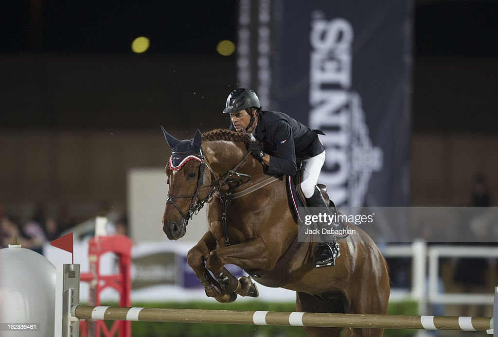 Frederic David of France clears a hurdle on Equador Van'T Roosakker during the President of the UAE Showjumping Cup - Furusyiah Nations Cup Series presented by Longines on February 21, 2013 in Al Ain, United Arab Emirates.