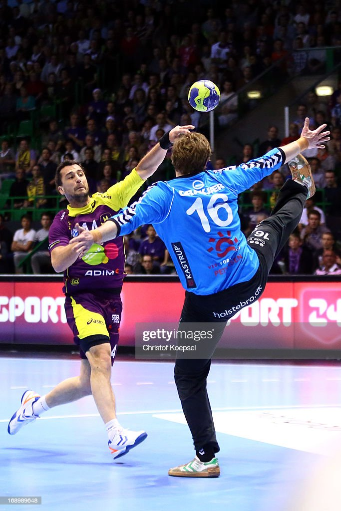Frederic Dole of Nantes scores a goal against Anders Petersen of Holstebro during the EHF Cup Semi Final match between Tvis Holstebro and HBC Nantes at Palais des Sports de Beaulieu on May 18, 2013 in Nantes, France.