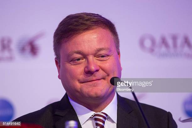 Frederic Gossot country manager for Germany and Austria at Qatar Airways Ltd reacts during a news conference at the ITB travel trade show in Berlin...