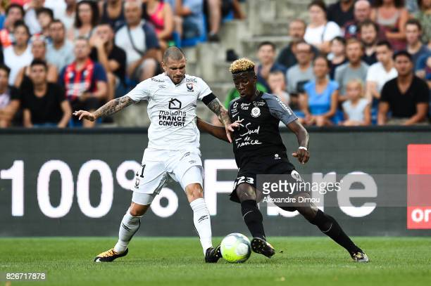 Frederic Guilbert of Caen and Nordi Mukiele of Montpellier during the Ligue 1 match between Montpellier Herault SC and SM Caen at Stade de la Mosson...