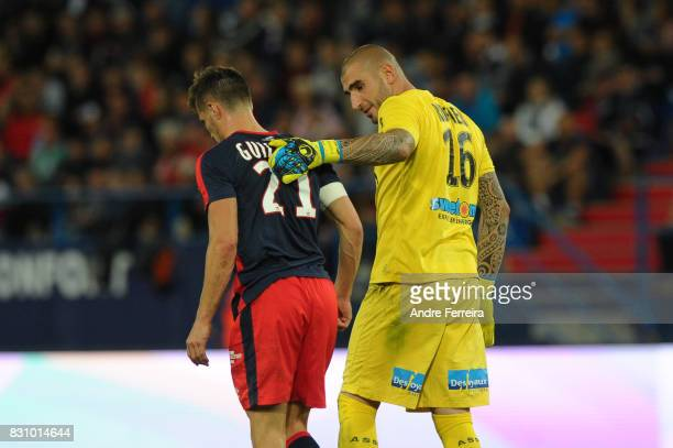 Frederic Guilbert of Caen and Stephane Ruffier of Saint Etienne during the Ligue 1 match between SM Caen and AS Saint Etienne at Stade Michel...